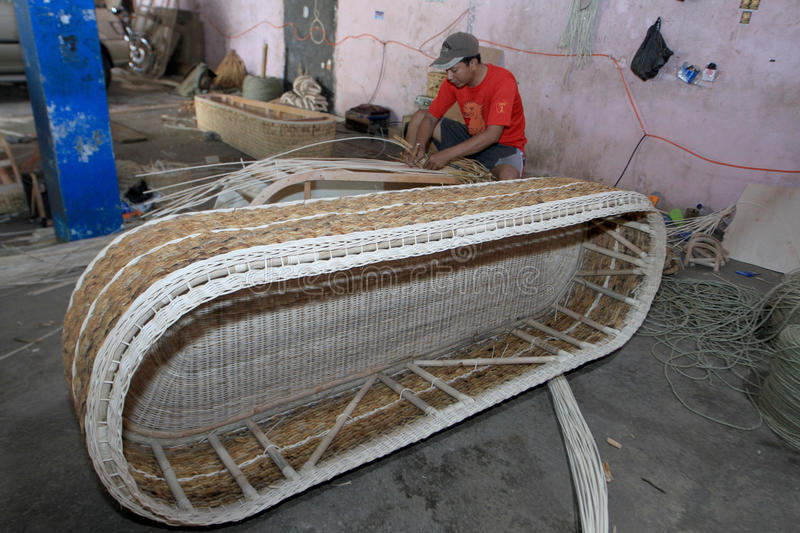 Coffins. Craftsmen were making coffins of rattan, in Sukoharjo, Central Java, Indonesia royalty free stock photo