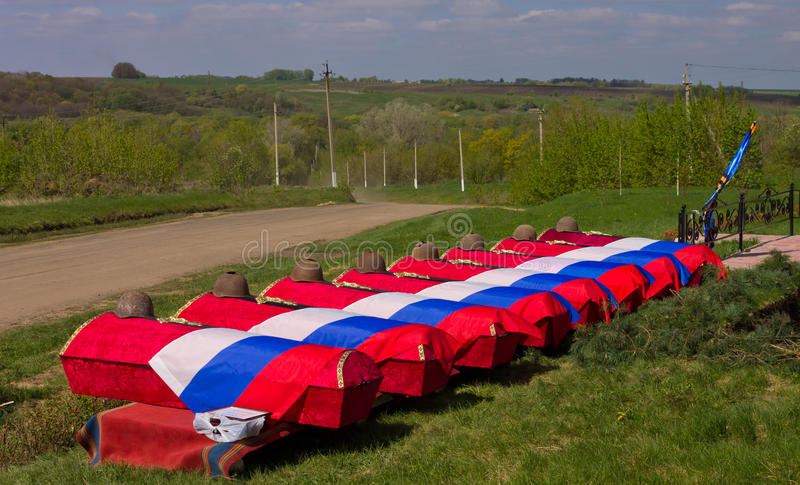Coffins with remains of Soviet soldiers covered with flags before the funeral. The funeral. Coffins with remains of Soviet soldiers covered with flags before stock photos
