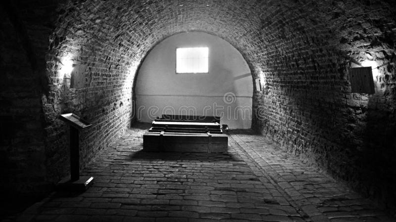 Coffins and tunnels at the Ceremonial Hall and Central Morgue of the former Jewish Ghetto at Terezin Czech Republic. Black and white Coffins and tunnels at the royalty free stock photos