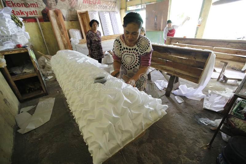 Coffins. The womans doing the making of coffins in the town of Solo, Central Java, indonesia stock photo