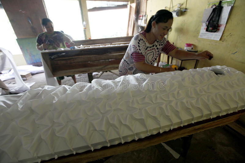 Coffins. The womans doing the making of coffins in the town of Solo, Central Java, indonesia royalty free stock image