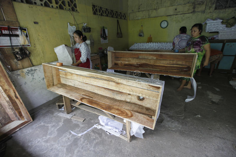Coffins. The womans doing the making of coffins in the town of Solo, Central Java, indonesia stock image