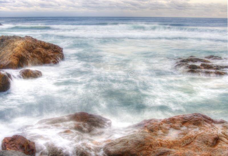 Coffs harbour water on rocks stock photo