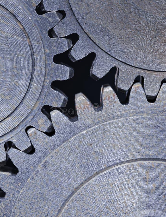 Cog wheels. Three old cog gear wheels in closeup stock photography