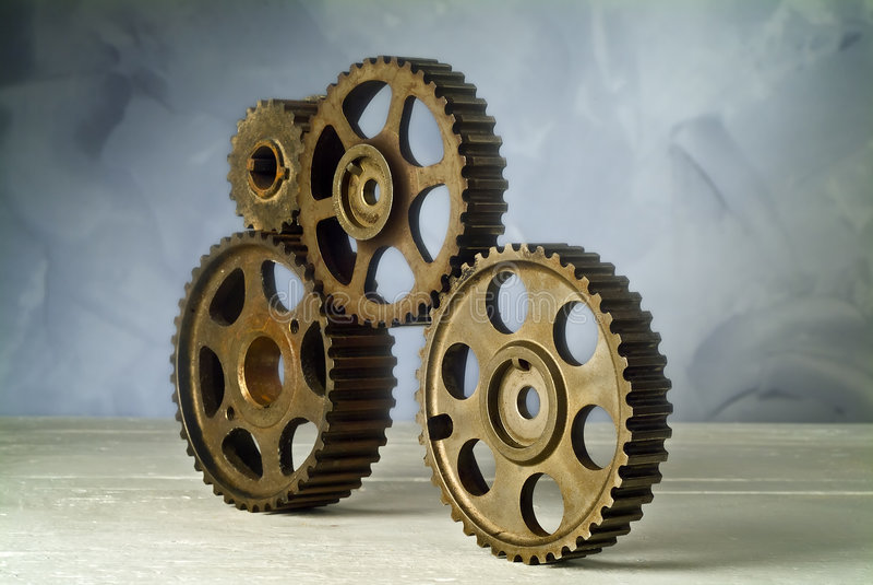 Cog-wheels. Studio still life of four cog-wheels stock photos