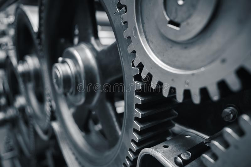 Cog wheels. Large cog wheels in the motor - blue toned royalty free stock photos