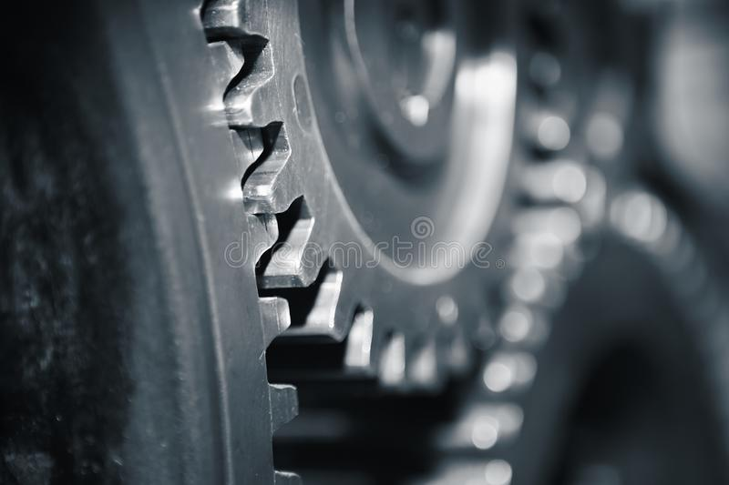 Cog wheels. Large cog wheels in the motor - blue toned stock photography