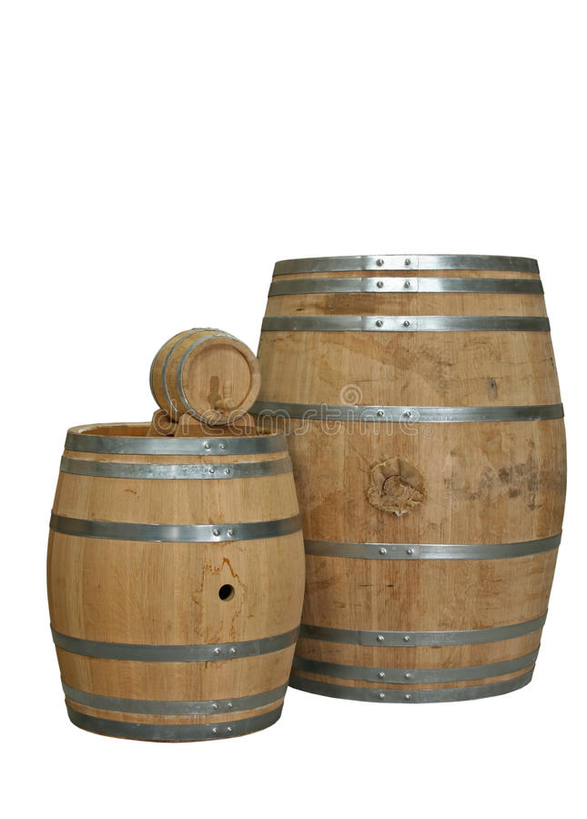 Cognac barrels. Selection of different sized oak cognac barrels isolated stock photos