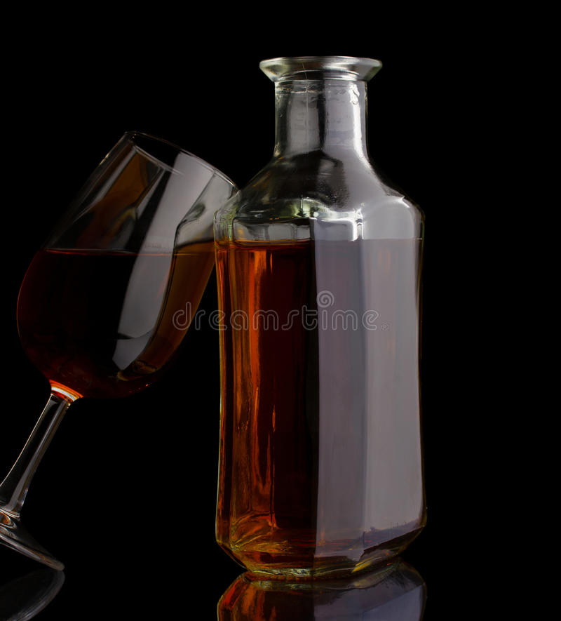 Cognac bottle and glass royalty free stock images