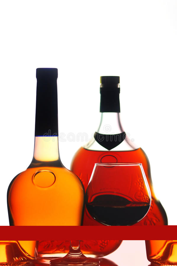 Free Cognac Bottles And Glass Stock Photography - 18147172