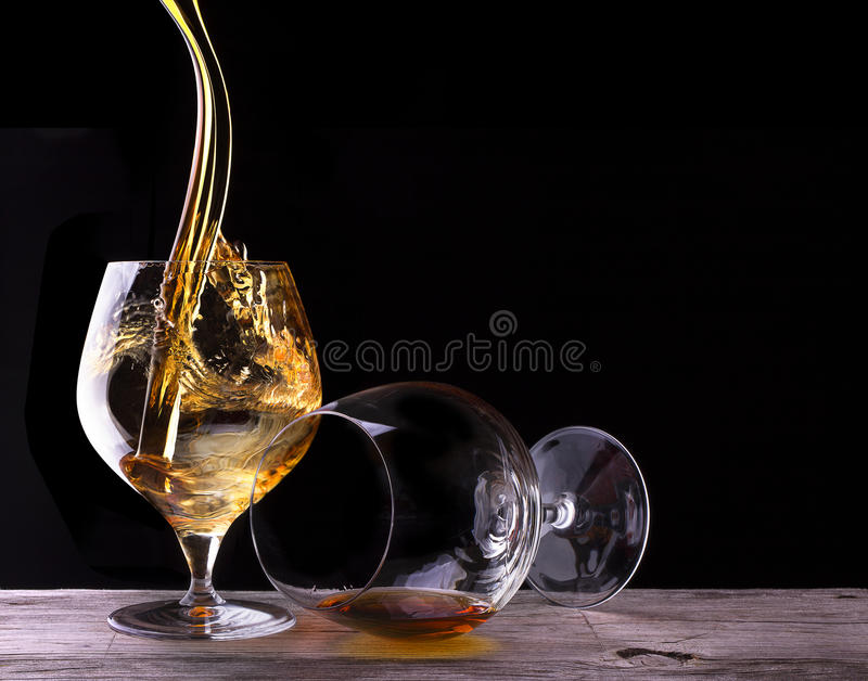 Cognac or brandy on a wooden table stock photo