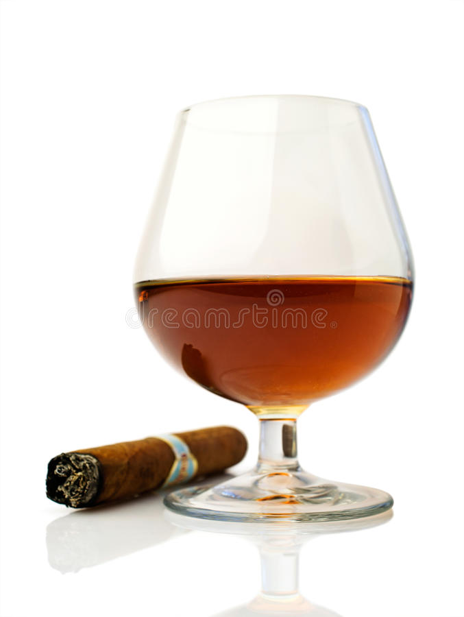 Cognac and cigar. Over white royalty free stock photos