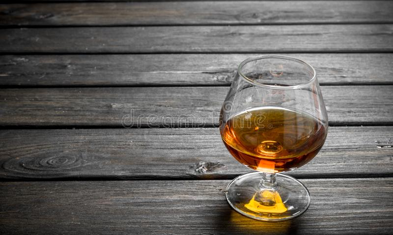 Cognac in a glass royalty free stock photo
