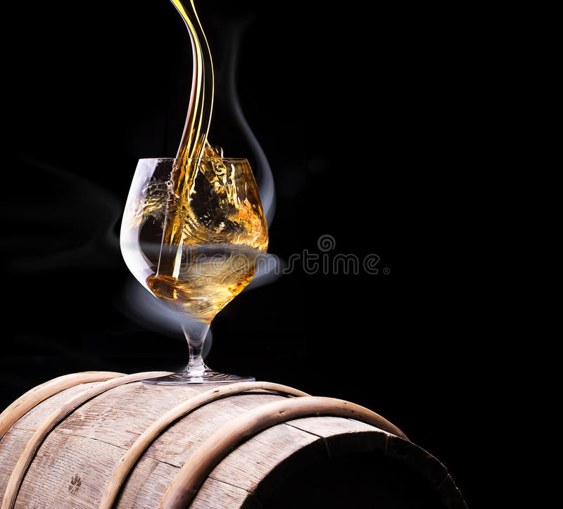 Cognac glass shrouded in a smoke royalty free stock images