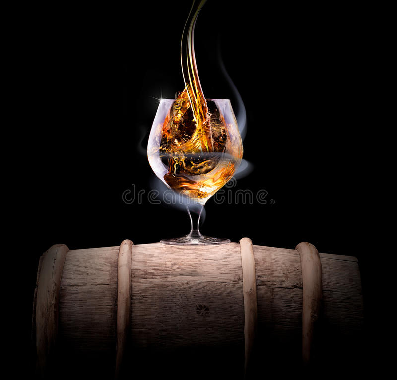 Cognac glass shrouded in a smoke royalty free stock photos