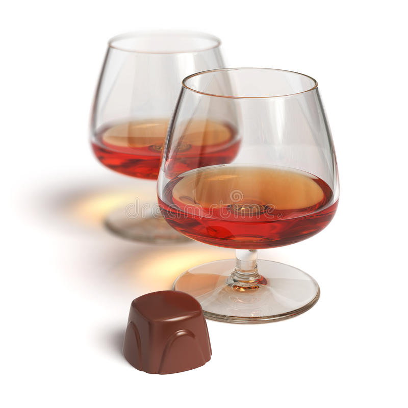 Cognac glasses and chocolate candy stock images