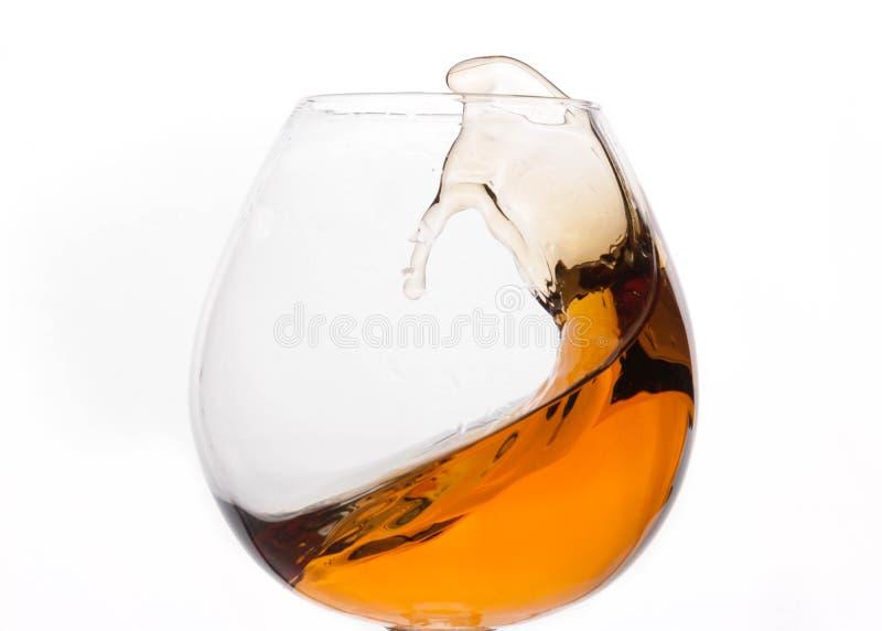 Cognac i genomskinligt exponeringsglas royaltyfri foto