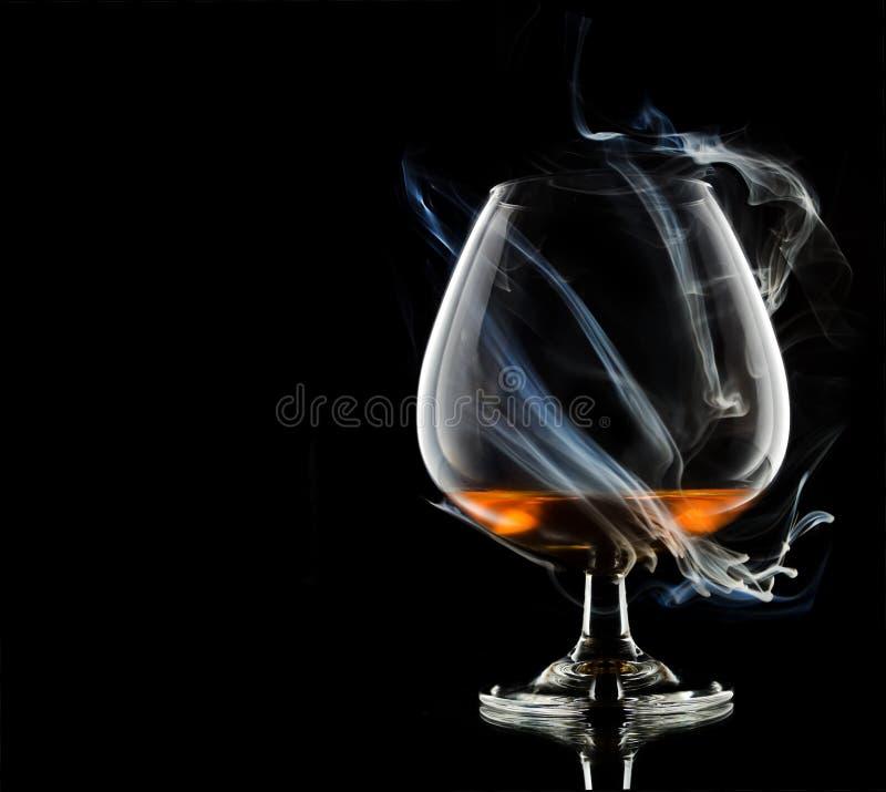 Cognac in smoke royalty free stock photos
