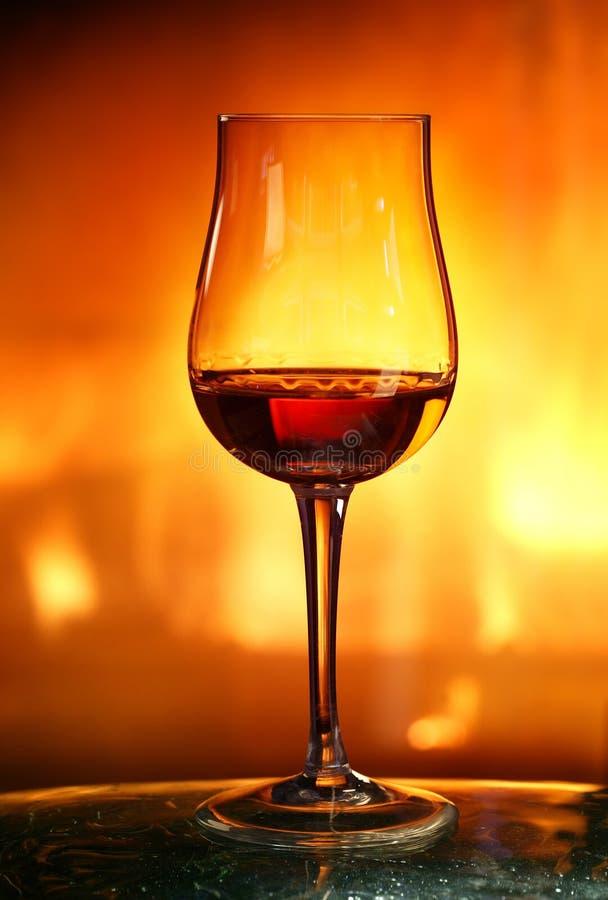 Cognac in tulip glass. New design of cognac glass stock image
