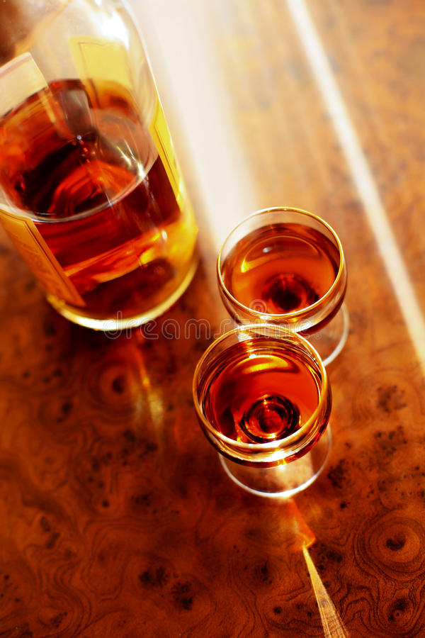 Cognac and two wine-glasses royalty free stock image