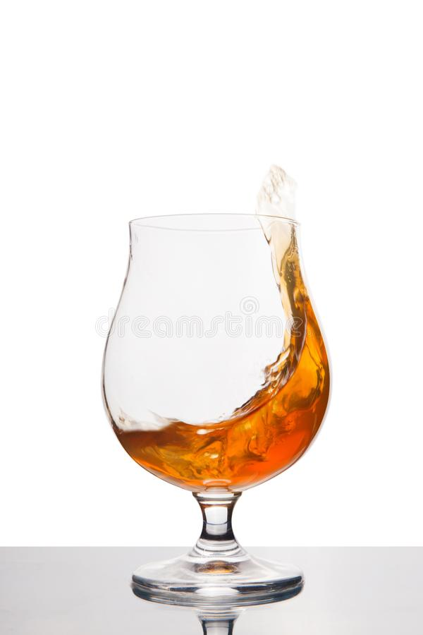 Cognac in wineglass isolated on white. Background. Alcohol drink stock image