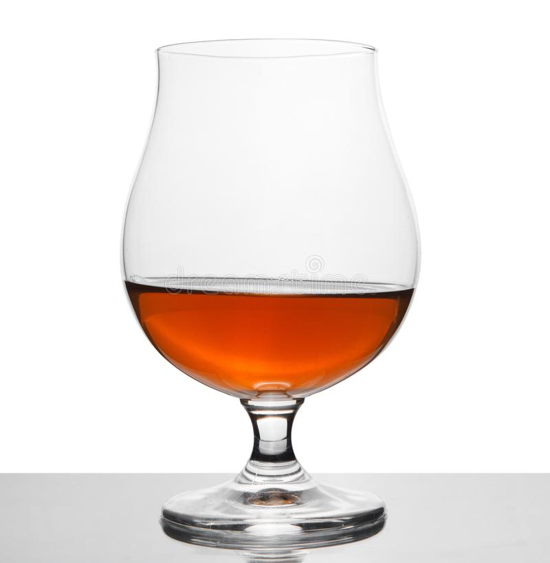 Cognac in wineglass isolated on white stock photo