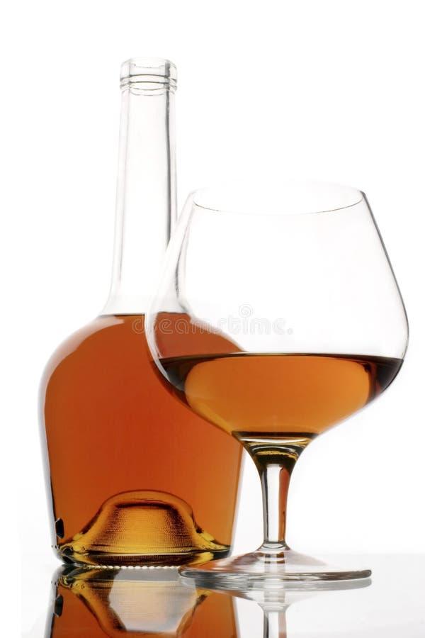 Cognacglas en fles royalty-vrije stock afbeeldingen