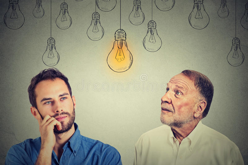 Cognitive skills concept, old man vs young person stock image