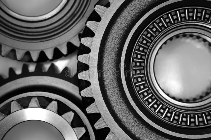 Cogs. Closeup of three steel cogs royalty free stock image