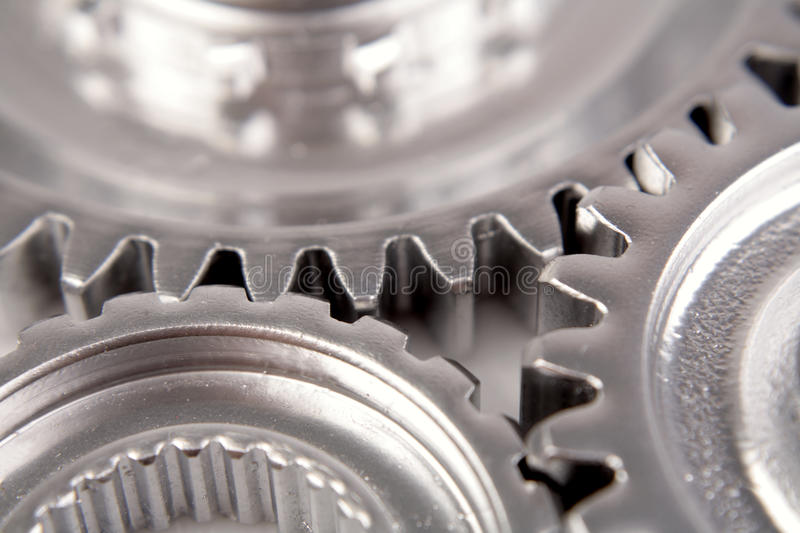 Cogs. Closeup of three steel cogs stock photography
