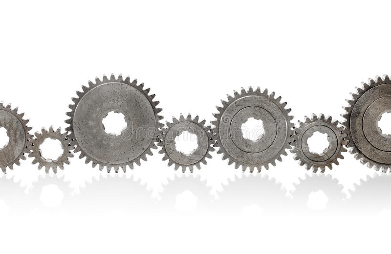 Cogs. Old metallic cog gears arranged in a row royalty free stock photos