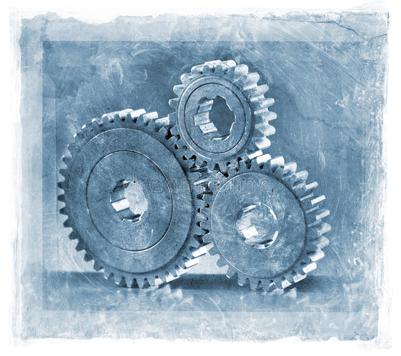 Cogs. Grainy and gritty manipulated photo of three cog gears royalty free stock photos