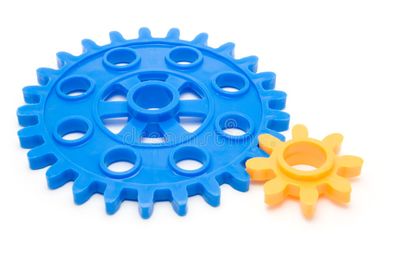 Cogs. Closeup of interlocked cogs isolated on a white background stock images