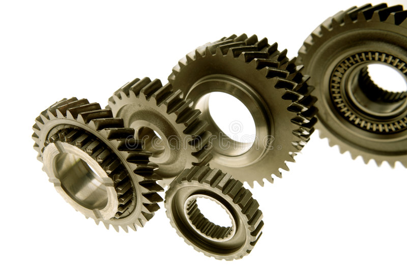 Cogs. Steel cogs over white background royalty free stock images