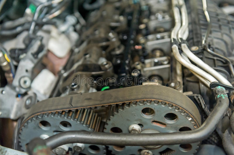 Cogs. In a car engine royalty free stock images