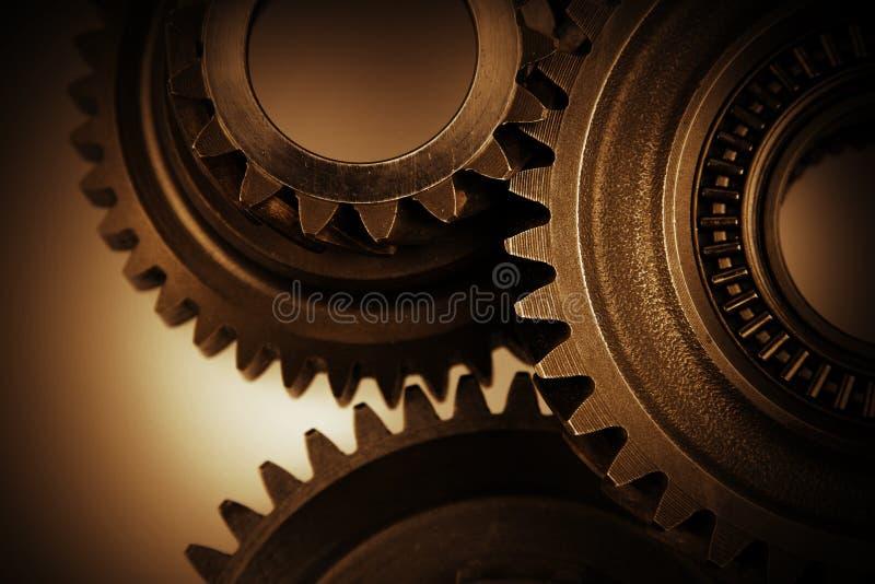 Cogs. Closeup of three metal cog gears stock photos