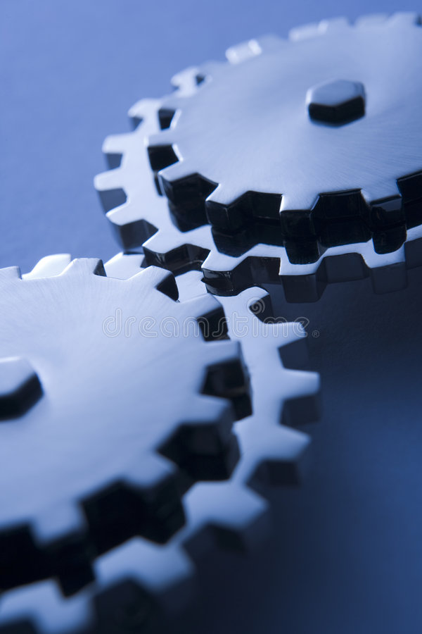 Cogs Fitted Together. On A Blue Background royalty free stock image