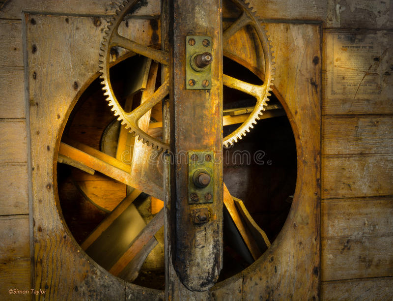 Cogs, Gears, Old Water Mill. The cogs & gears in Salford Water Mill in Surrey UK. Picture taken 15th May 2015 stock images