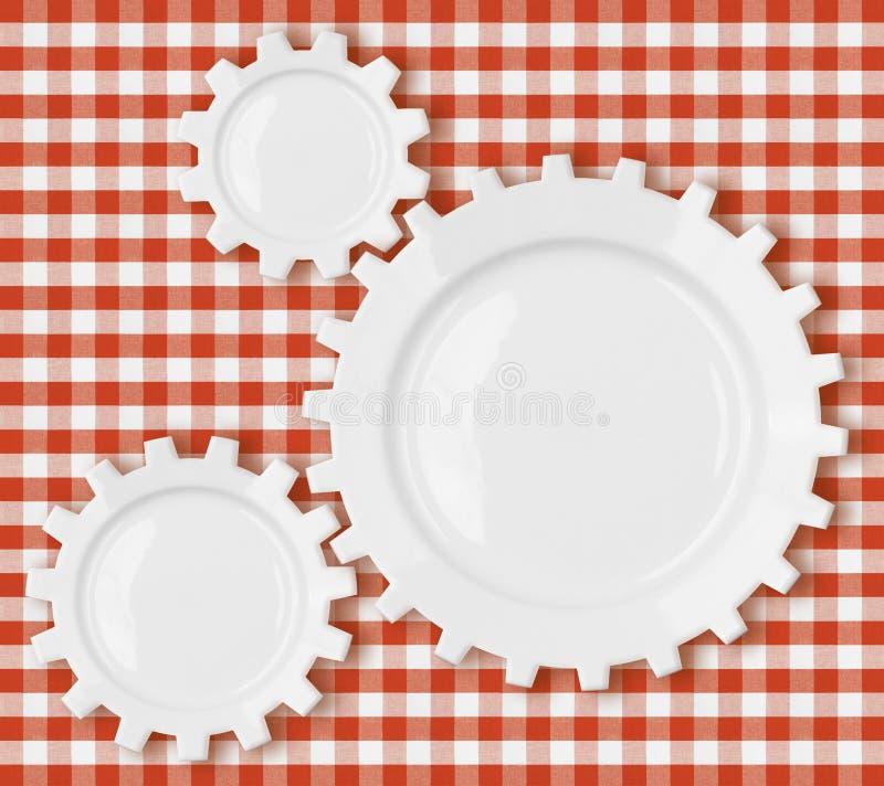 Cogs i przygotowywają talerze nad czerwonym pyknicznym tablecloth obrazy stock
