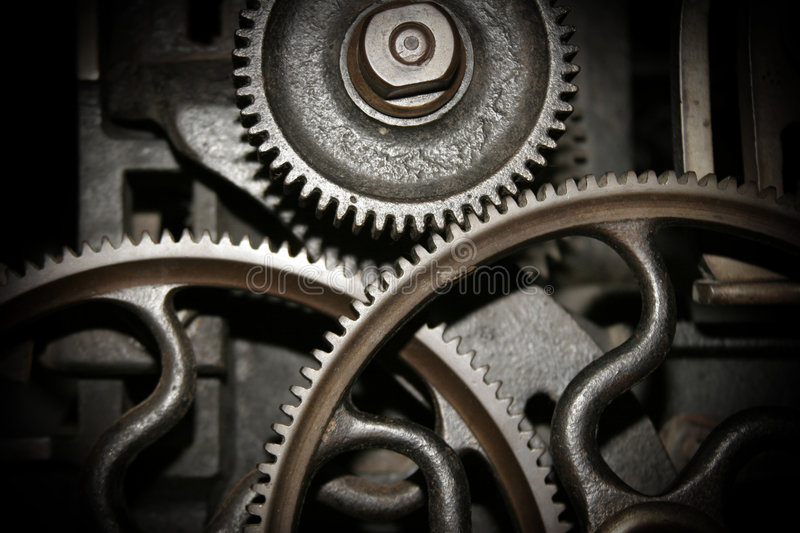 Cogs in a machine. Cog and wheel details from machines of the industrial revolution royalty free stock photography