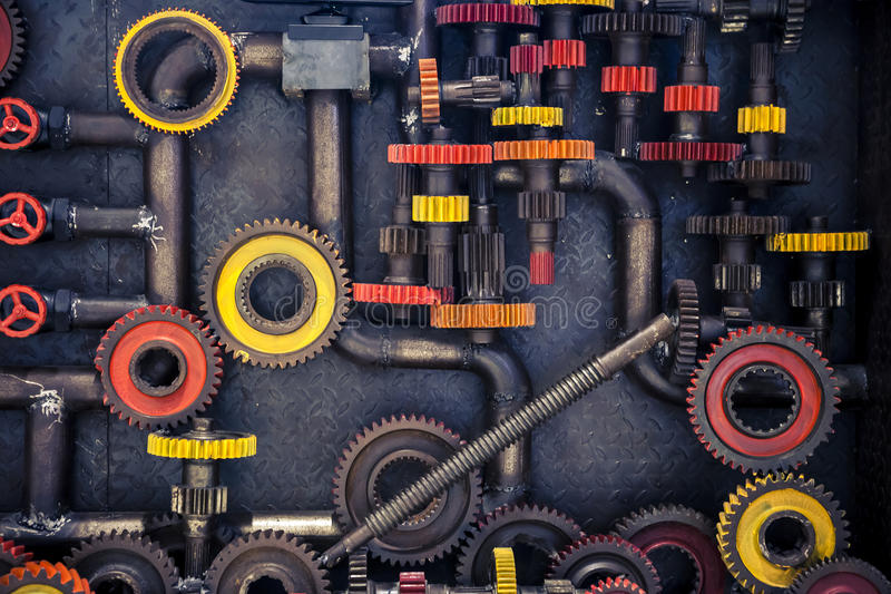 Cogs and pipes. Old wheel gear cogs with steam pipes background royalty free stock photography