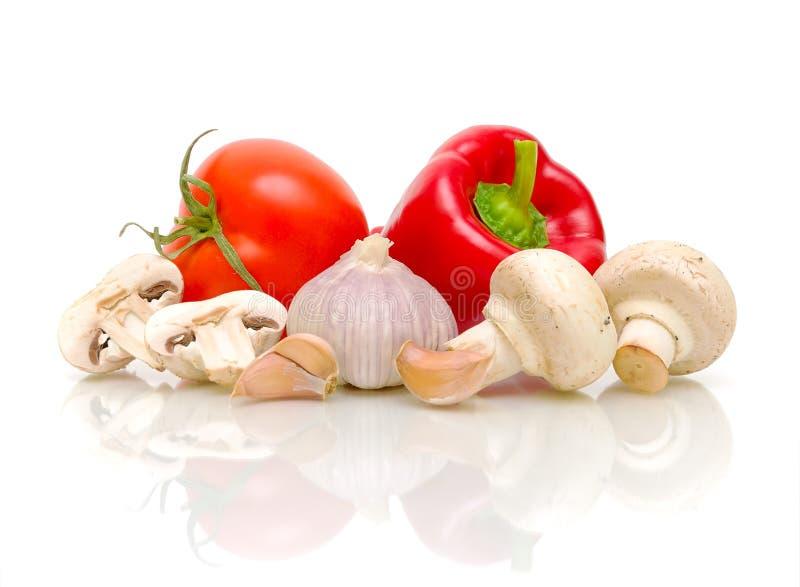 Cogumelos, tomates, alho e pimentas fotos de stock