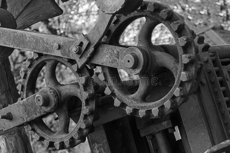 Cogwheel λεπτομέρειας στοιχείων γκρίζος τονισμένος grunge υποβάθρου σχεδίου βάσεων εφαρμοσμένης μηχανικής άξονας μηχανισμών εφαρμ στοκ εικόνες
