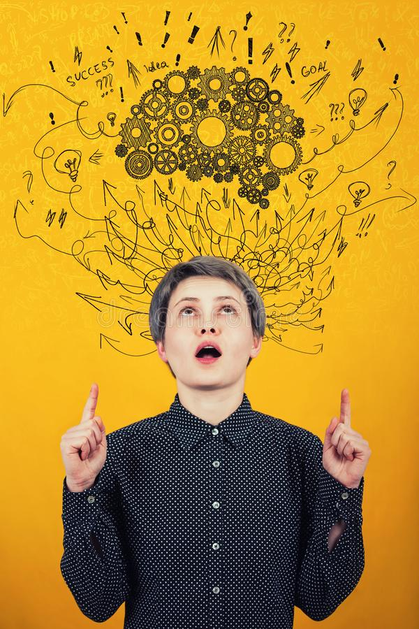 Cogwheel brain above head. Hard thinking, arrows and curves mess as thoughts. Mental development concept royalty free stock images