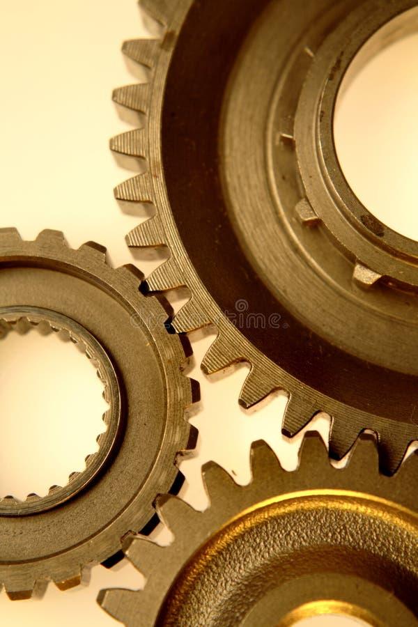 Cogwheels. Three steel cogwheels joining together royalty free stock photos