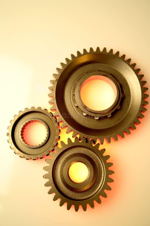 Cogwheels. Closeup of three cogwheels together royalty free stock photo