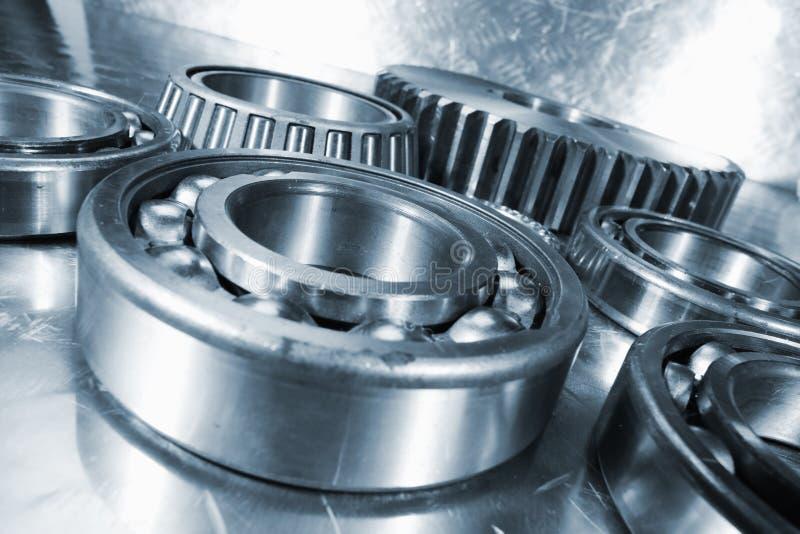Cogwheels and ball-bearings. Titanium engineering ball-bearings and cogwheels in close-ups royalty free stock images