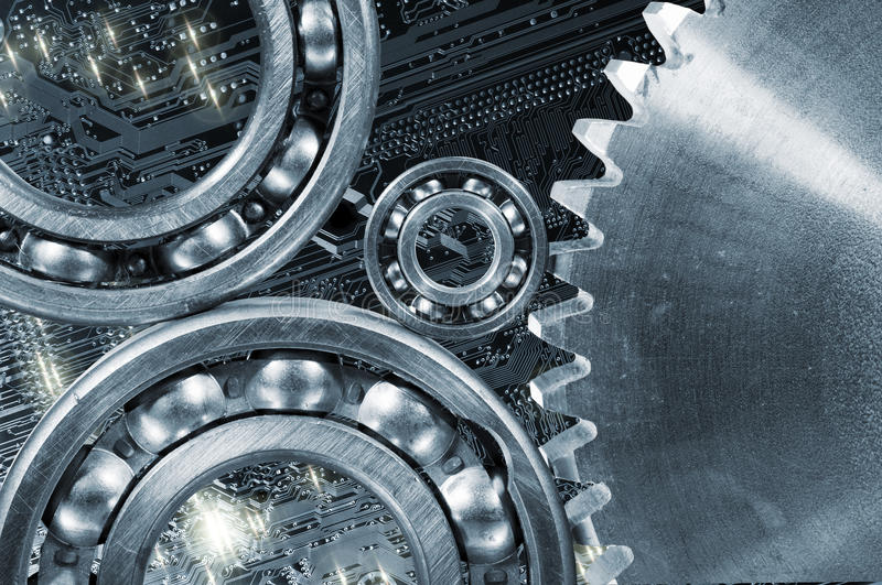 Cogwheels and gears computer calibrations. Cogwheels and ball-bearings calibrated and set against a computers circuit-board stock image
