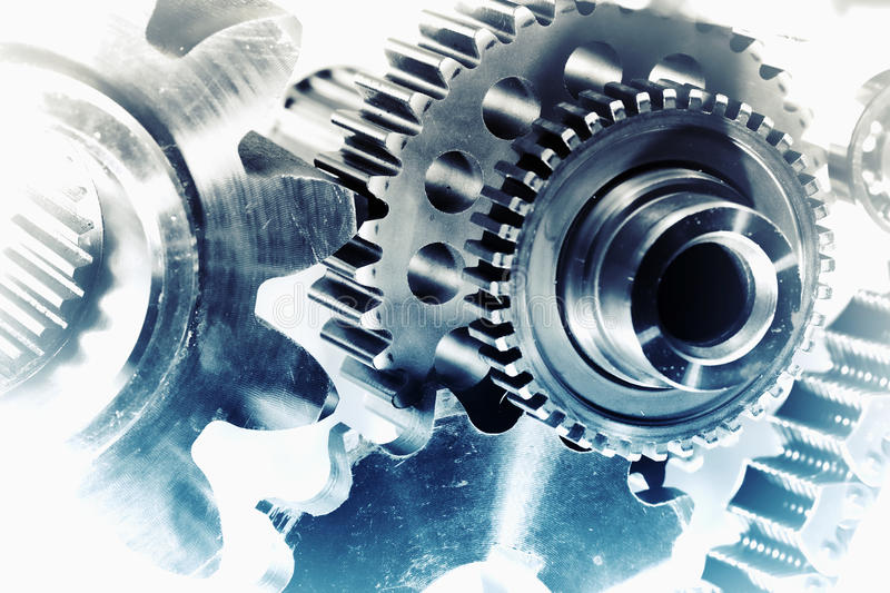Cogwheels and gears in vintage concept royalty free stock photo