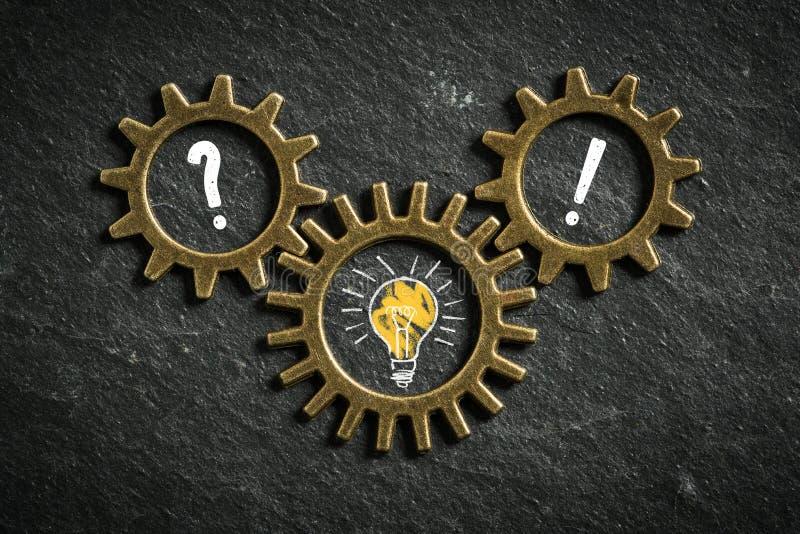 Cogwheels symbolizing an idea process. On slate background stock photo
